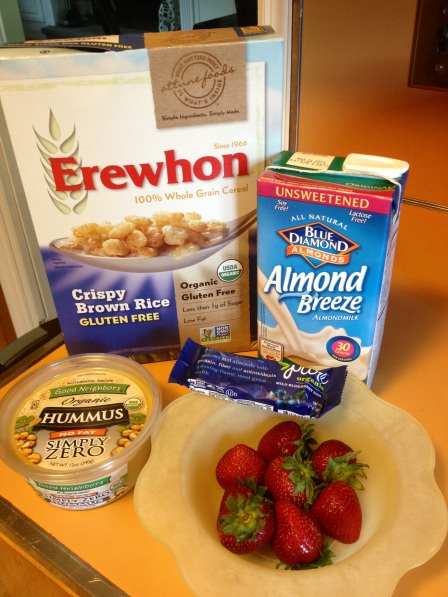 Some of my favorite snacks - gluten free cereal, almond milk, fat-free hummus, strawberries, and pure organic blueberry bars